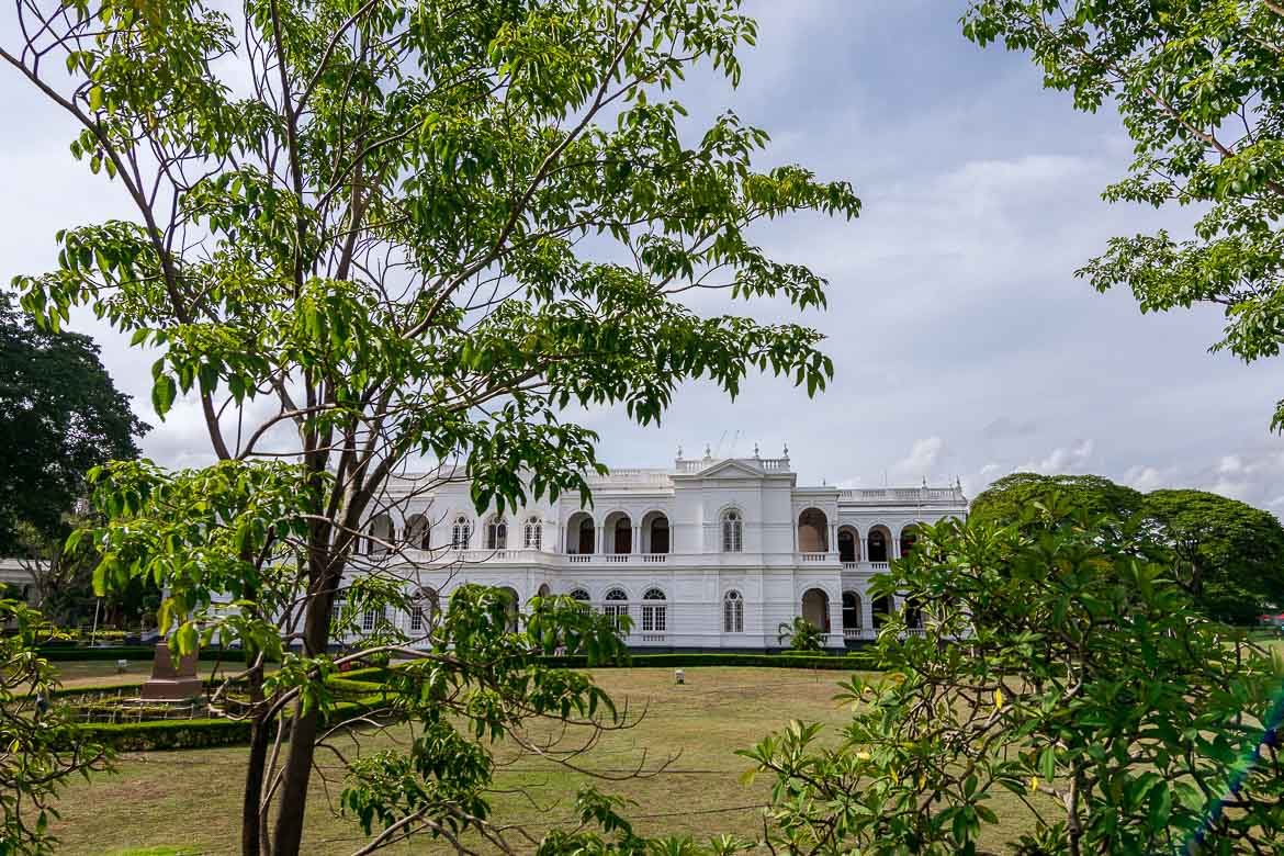 This is a photo of the exterior of the national museum. It is a large white building surrounded by trees.
