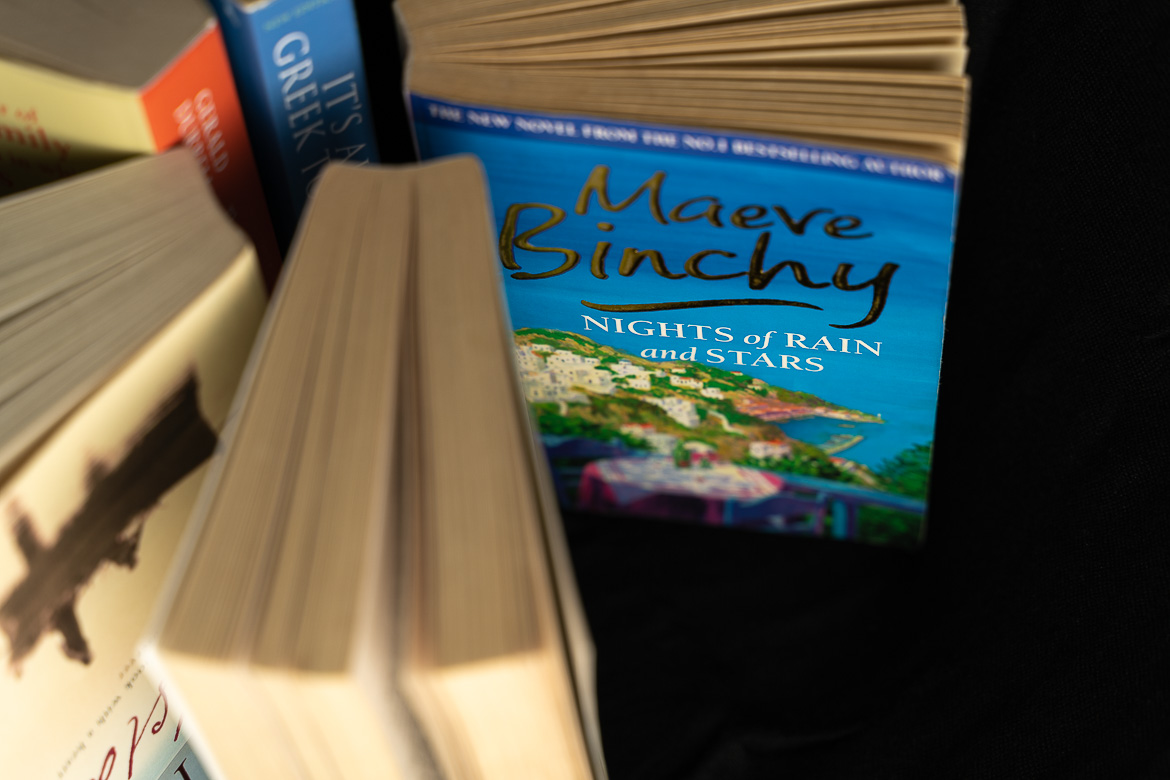This image shows a series of books with Maeve Binchy's Nights of Rain and Stars in the foreground.