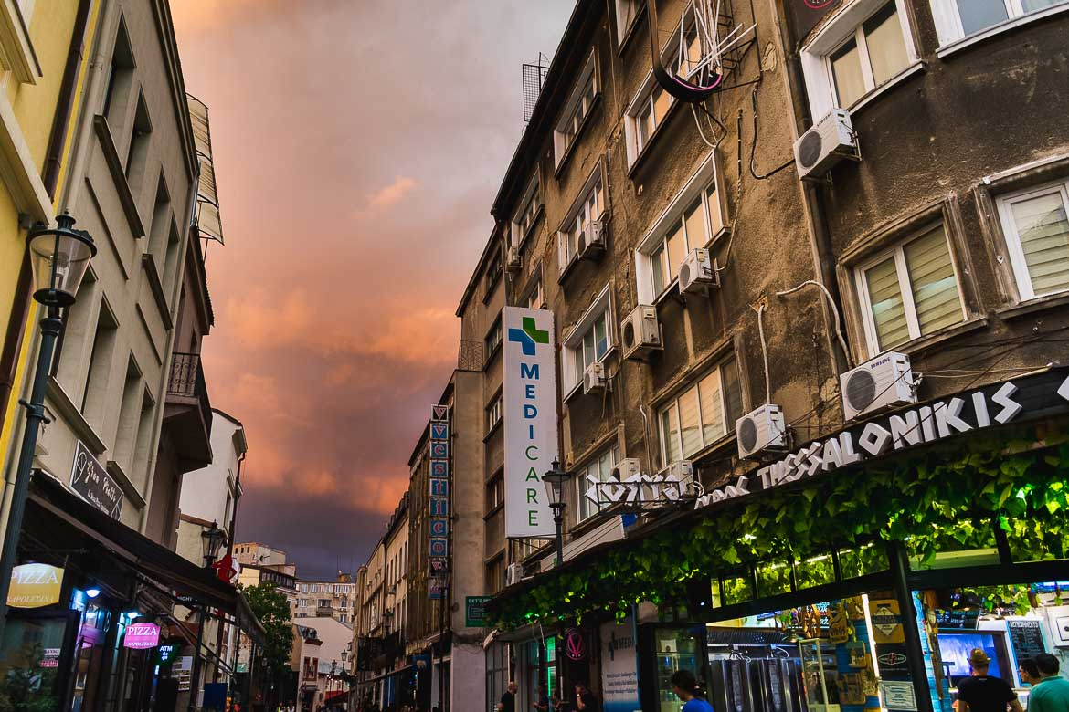 This is a photo of Bucharest Old Town under a dramatic sky before a storm. Strolling around the cobblestone streets of the old town is one of the top things to do in Bucharest, Romania.