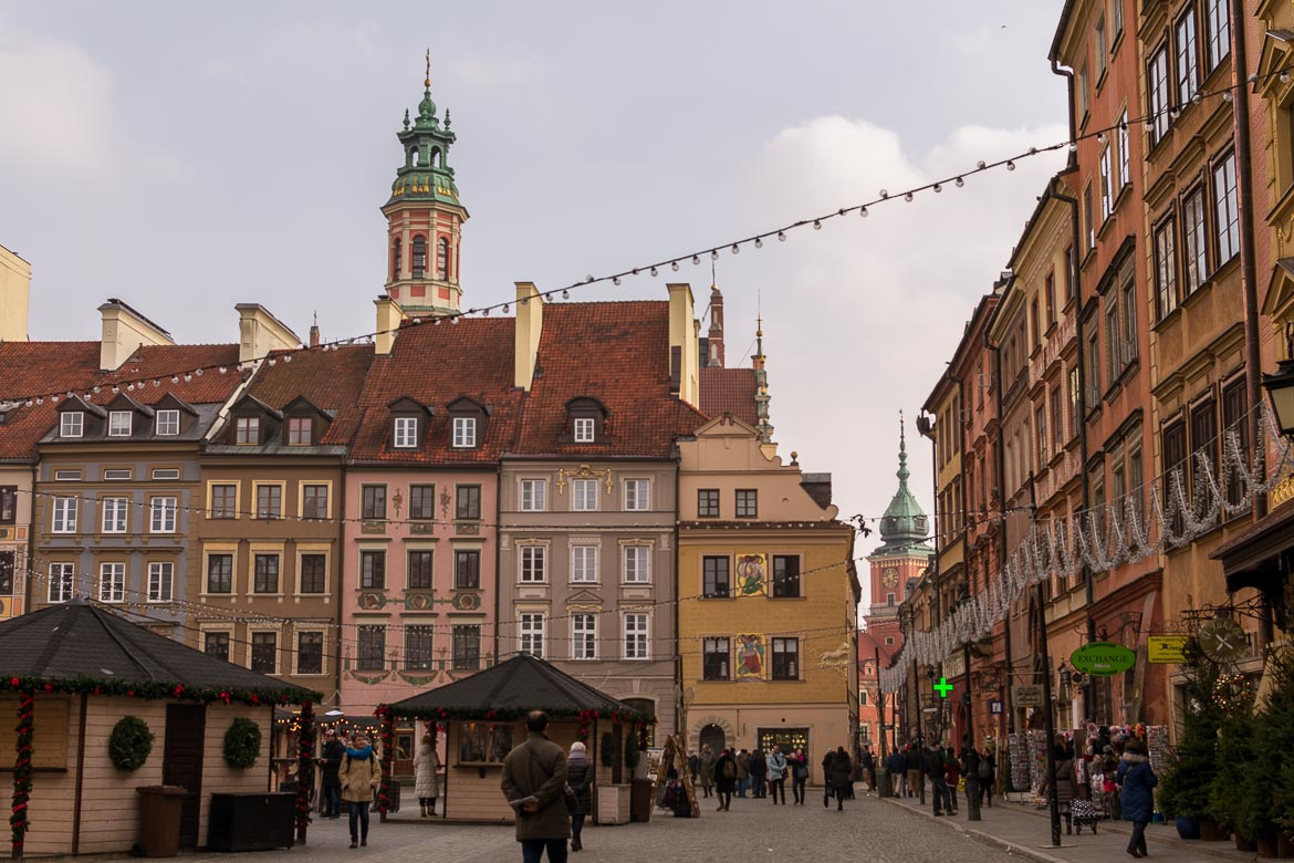 The Old Town Market Place in Warsaw Poland feels very festive in winter. Christmas kiosks and an ice rink stay put after the holidays are over. Winter in Warsaw. Top things to do and Warsaw city guide.