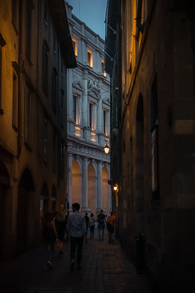 This is a wonderful evening shot of the Palazzo Nuovo dimly lit and contrasting with the dark street that leads to it.