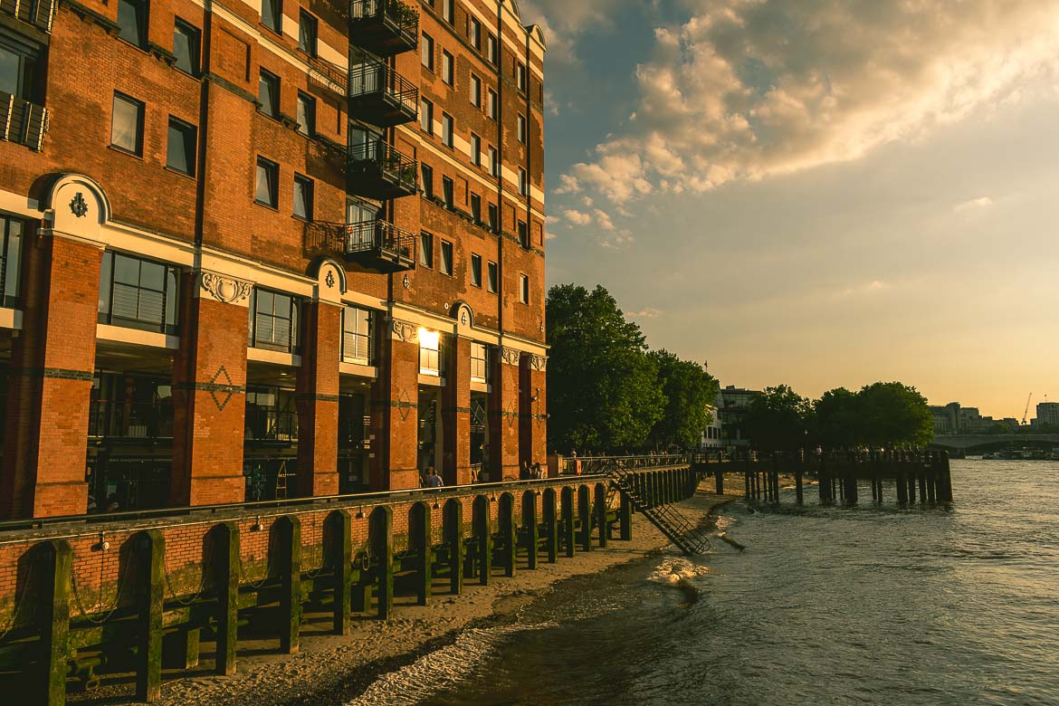 This photo shows a beach of sorts right outside Oxo Tower, London, England. South Bank walk.