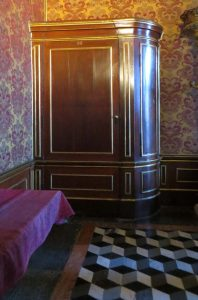 This photo shows a wardrobe which is actually a secret passageway in Palazzo Ducale in Venice, Italy. What to do in Venice: our complete guide to La Serenissima.