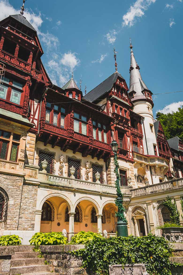 This is a photo of Peles Castle in Transylvania, Romania. You can visit Peles on the same day trip from Brasov to Bran Castle.