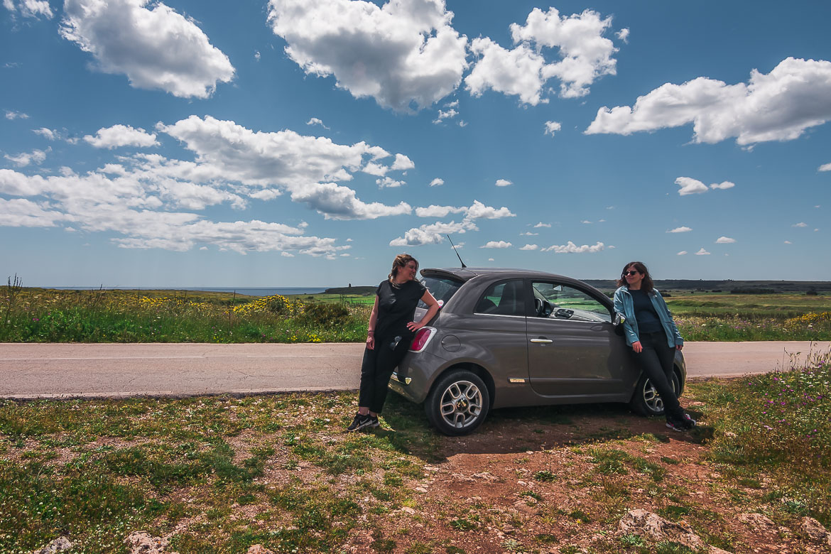 This photo shows Katerina and Maria leaning against their Fiat 500 under a glorious sky somewhere in the countryside of Puglia Italy. We are both smiling and super happy to be road tripping across our favourite country and this is why we chose this photo to welcome you all to our homepage!