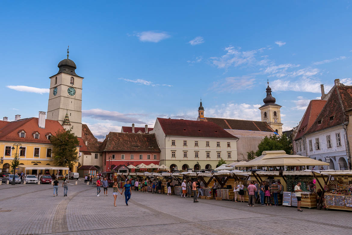 Piata Mica in Sibiu Old Town is dominated by the Council Tower. 11 amazing things to do in Sibiu Romania.
