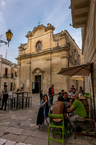 This is a photo of Piazzetta Chiesa Greca in Lecce. It is dotted with cosy cafes and bars.