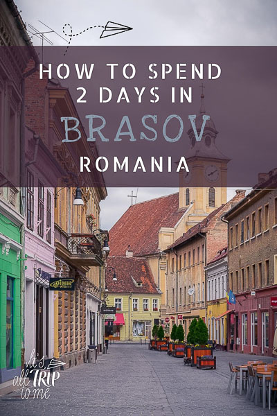 This image shows a picturesque street in Brasov Old Town. The street is lined with colourful buildings. This is an optimised pin for Pinterest. There is overlay text that reads: How to spend 2 days in Brasov Romania.