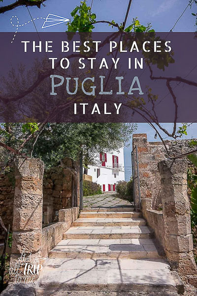 This image shows a few stairs that lead to the main courtyard at Masseria Torre Coccaro. This is an optimised pin for Pinterest. There is overlay text that reads: The best places to stay in Puglia Italy. If you like our article, pin this image!