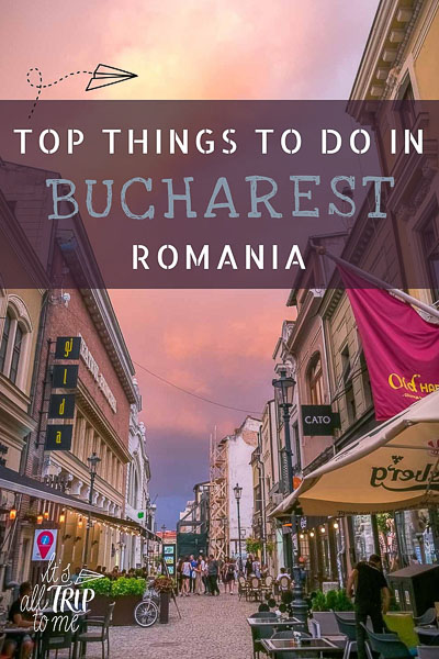 This is a photo of a street in Bucharest Old Town at sunset on a summer day. It is a cobblestone street lined with beautiful old buildings. There are tables and chairs outside on both sides of the street. The sky is a dramatic pink colour. This is an optimised image for use on Pinterest. There is overlay text that reads: Top things to do in Bucharest Romania. If you like our article, please pin this image.