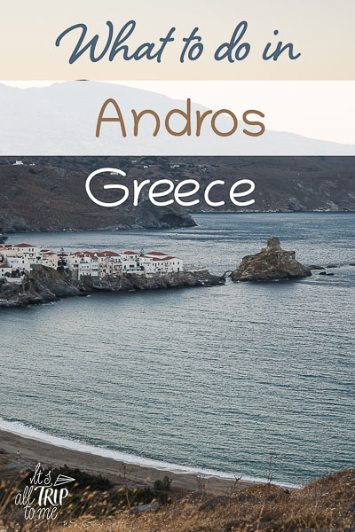 This image shows a panoramic view of Andros Chora. It's an optimised image for Pinterest. There is overlay text that reads: What to do in Andros Greece. If you like our article, please pin this image!
