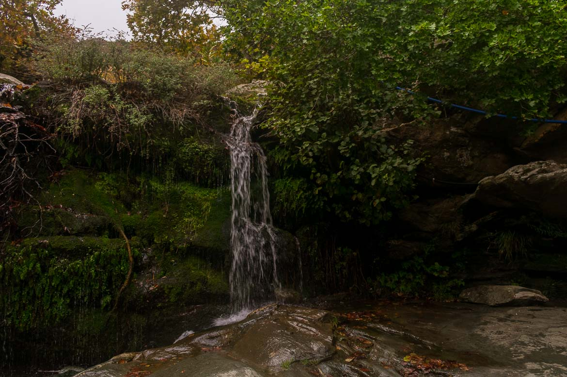 The Pithara Waterfalls at Apikia village in the midst of lush greenery.