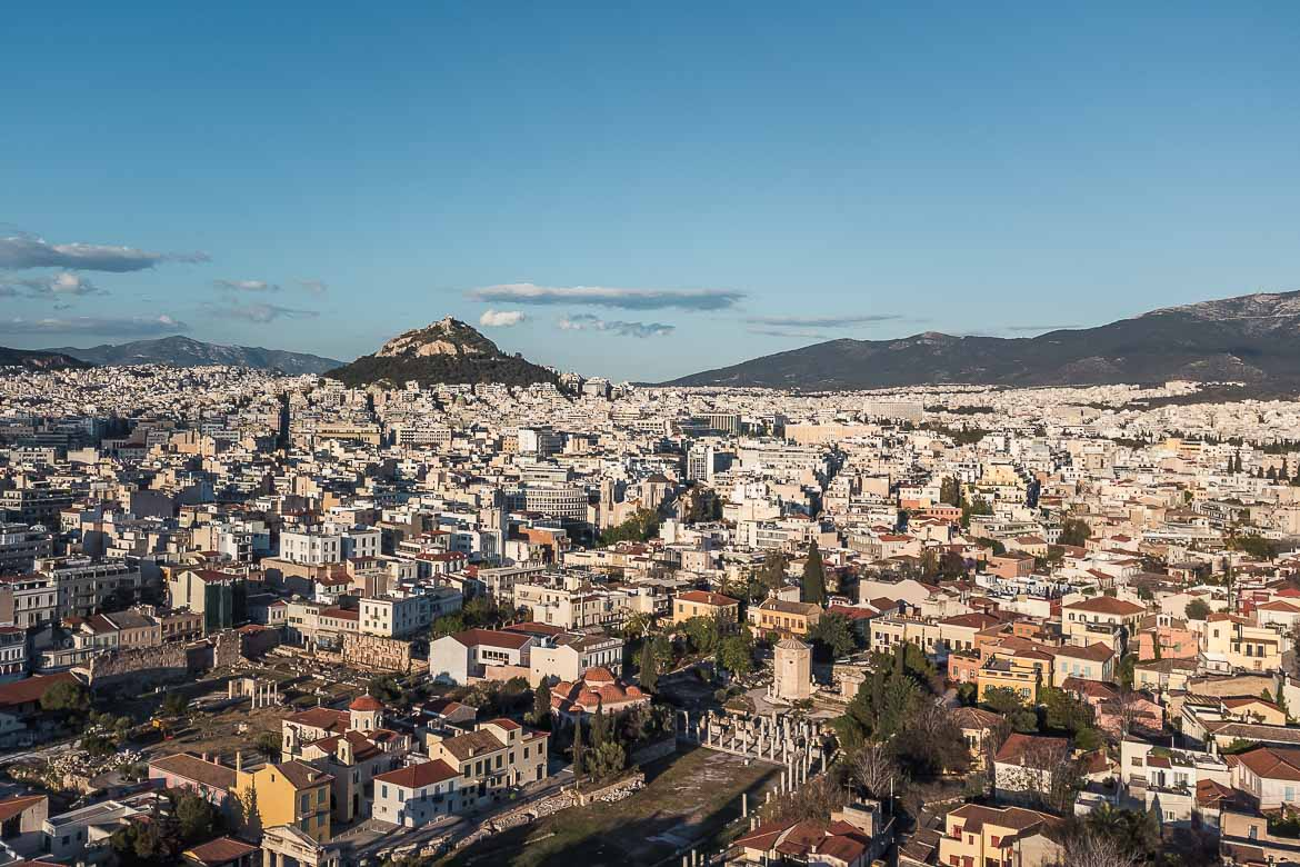 This image shows a panoramic view of Athens. In the background we can see Lycabettus hill.