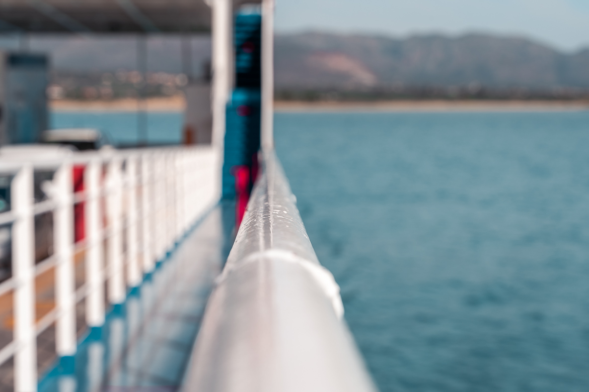 This is a close-up of the rail of a ferry.