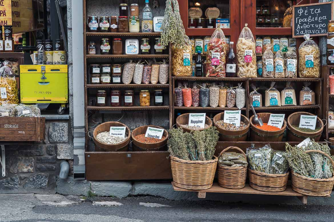 This image shows the storefront of a shop with Greek local products.