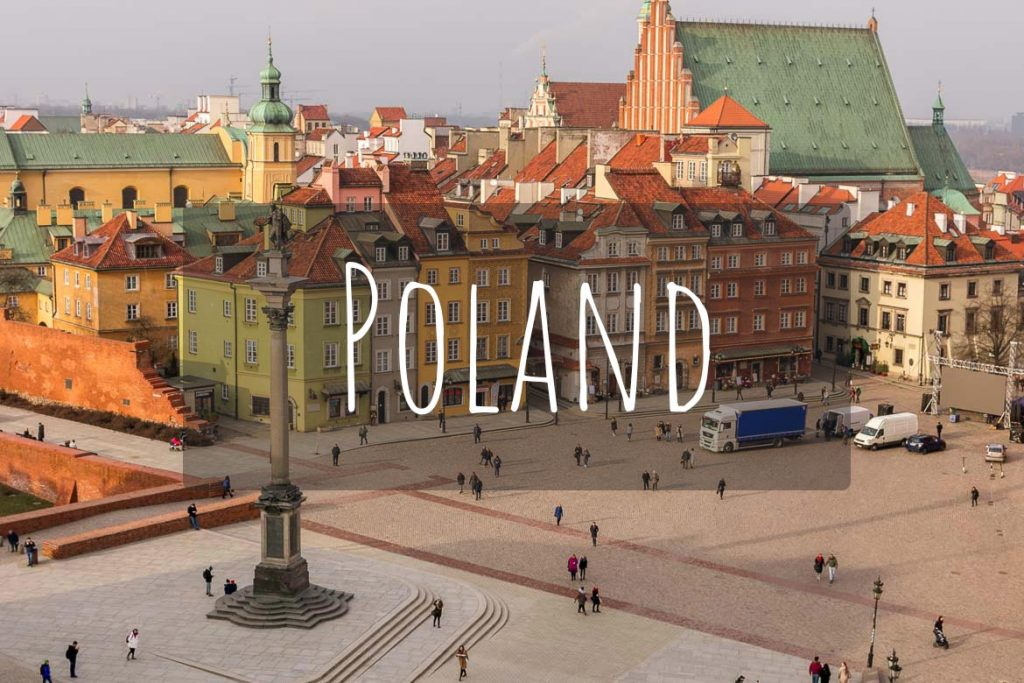 This image shows a panoramic view of Castle Square in Warsaw Old Town. It's the cover photo of Poland as a destination.