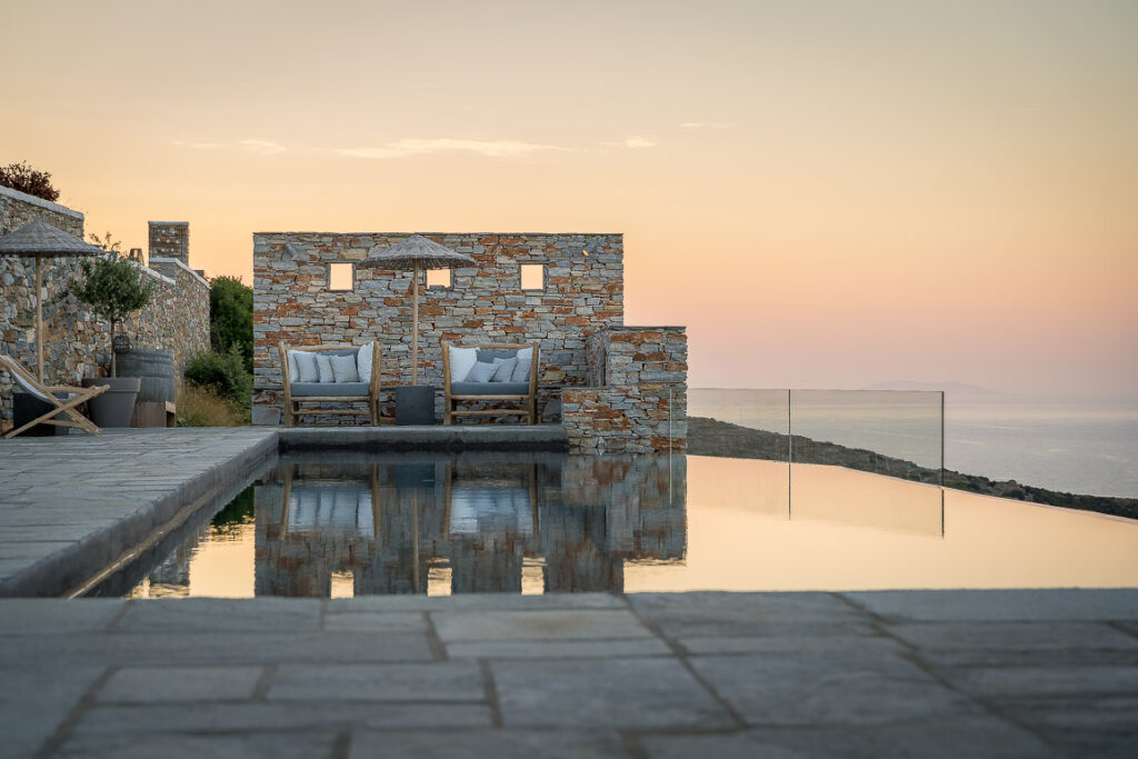 This image shows the swimming pool area of Verina Hotel in Sifnos at sunset.