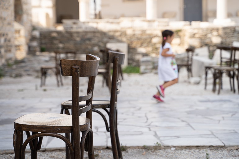 This image shows some empty chairs at a church's courtyard.
