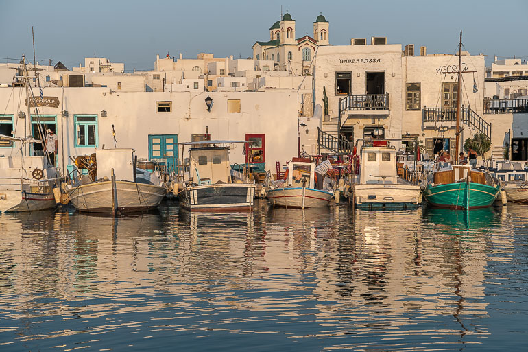This image shows a panoramic view of Naoussa's old port in Paros Greece.