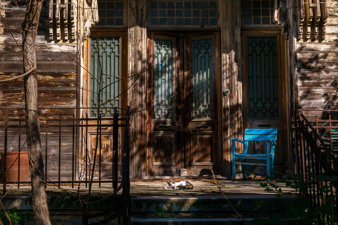 A magnificent entrance to a seemingly abandoned wooden mansion on Buyukada Island. Princes Islands day trip from Istanbul.