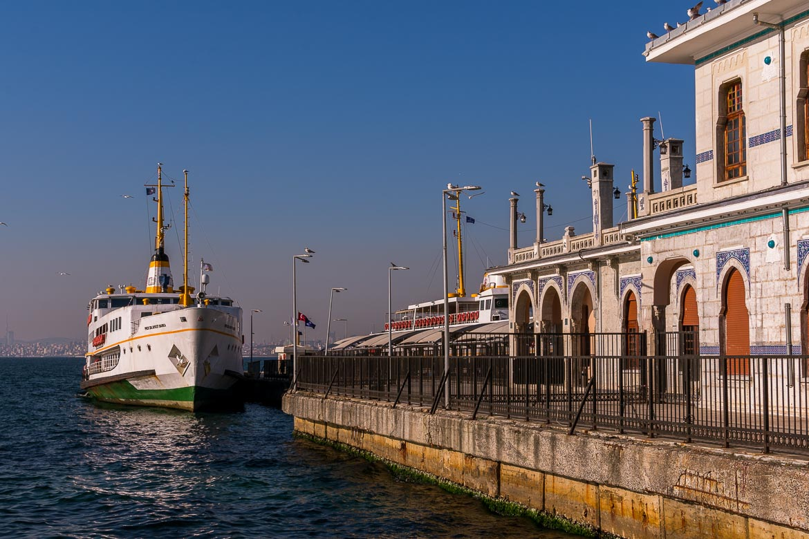 This photo shows the pier on Buyukada Island with the ornate station building and a Sehir Hatlari ferry anchored next to it.