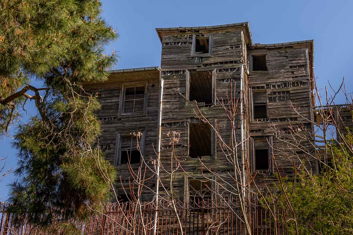 This image shows the abandoned wooden building of the Greek Orphanage on Buyukada Island.