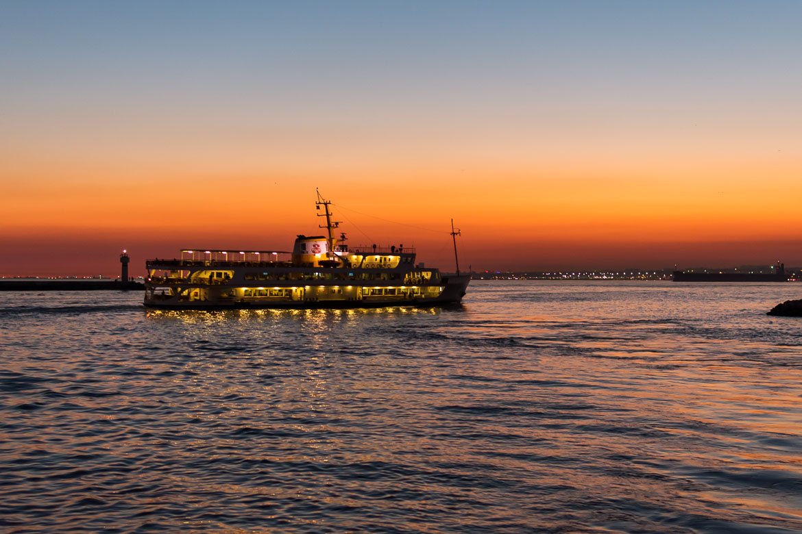 This photo shows a Sehir Hatlari ferry sailing in the Sea of Marmara during sunset.