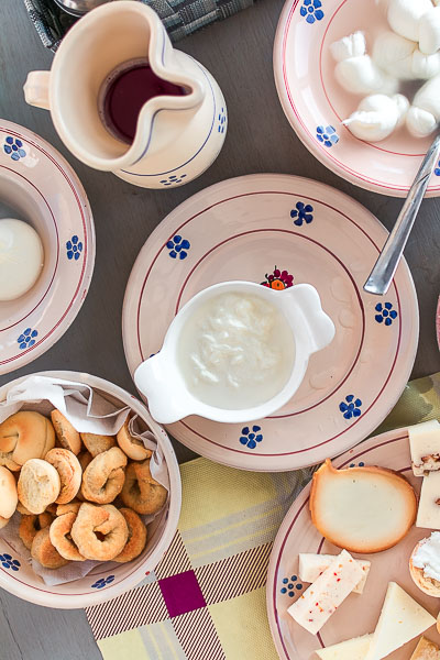 This image shows various cheese types and a bowl of tarallini.