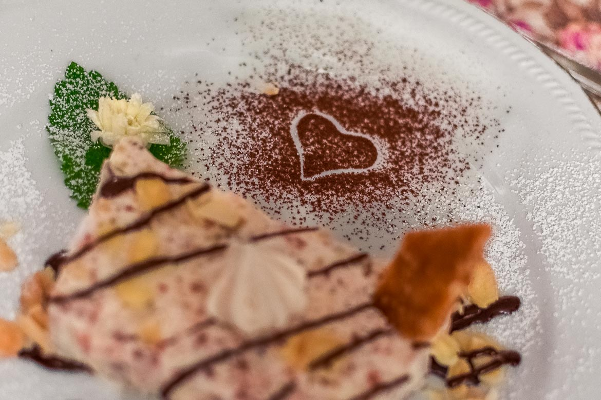This is a close up of dessert adorned with a heart of cocoa at Masseria Il Frantoio.