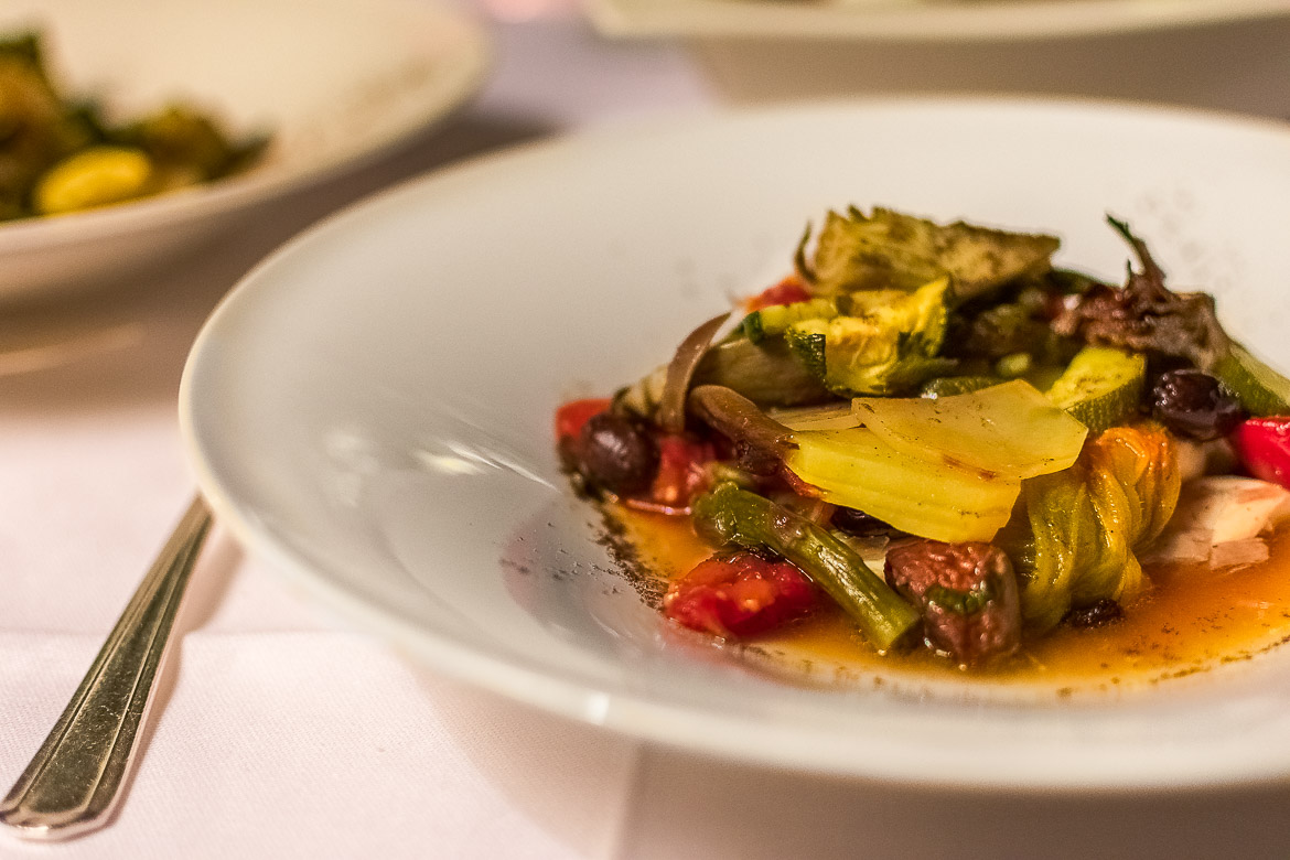 This is a close up of a dish of Fish with vegetables in the oven.