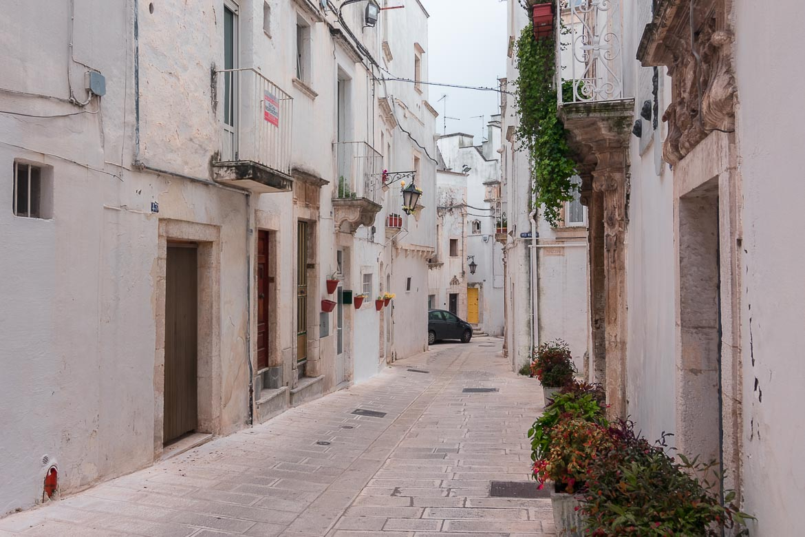This image shows the historic centre of Martina Franca. There is a car in the background.