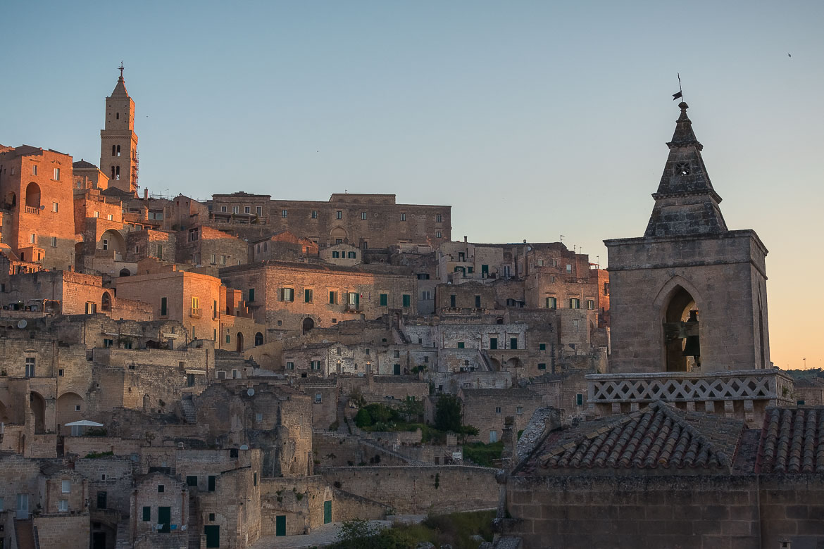 This image shows the Sassi of Matera dyed in the colours of sunrise. This is one of the most beautiful things we witnessed during our 2 weeks in Puglia road trip itinerary.