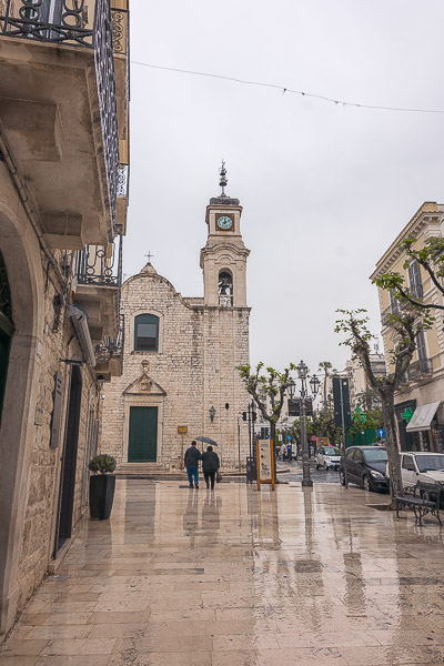 This photo was shot in Trani Old Town while it was raining heavily. The streets are filled with water.