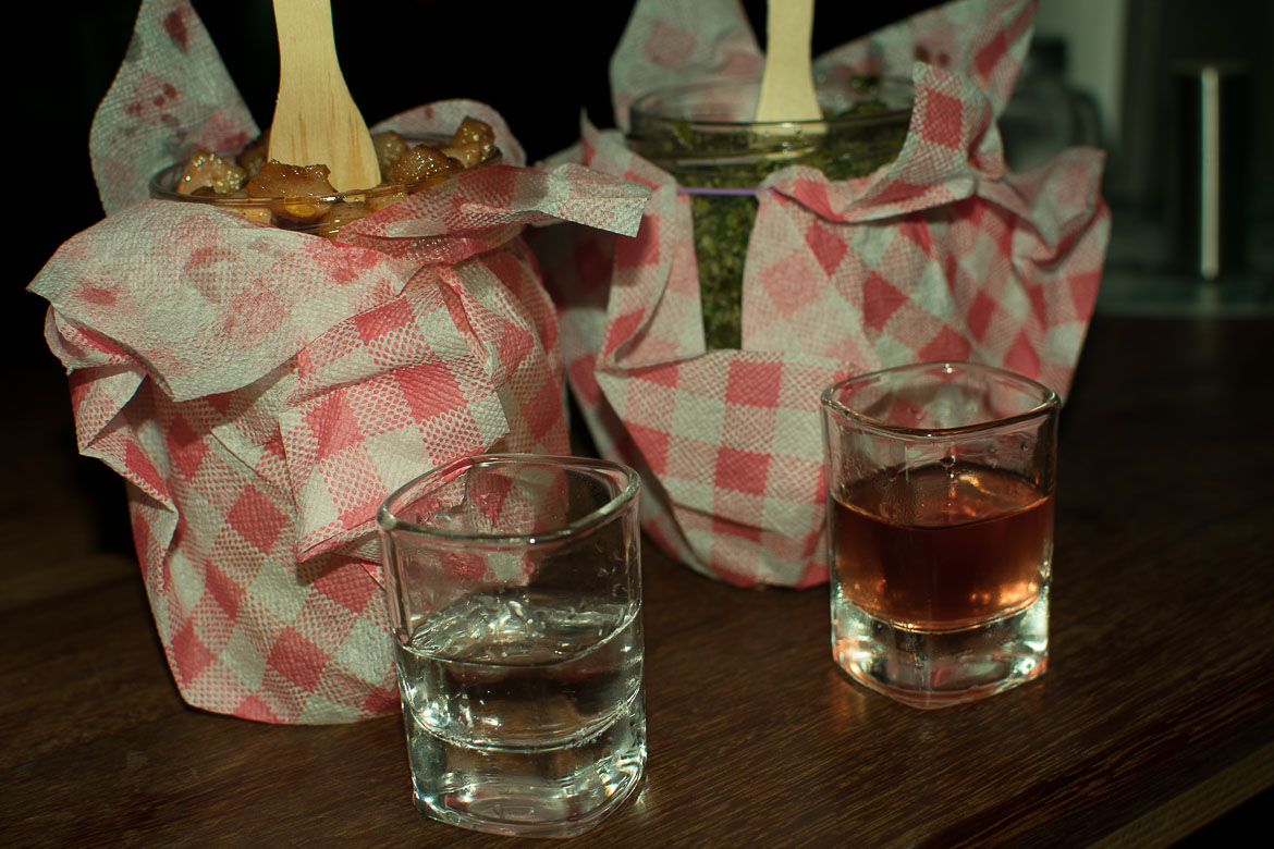 Pyzy Flaki Gorące. One of the best eateries at Praga district in Warsaw Poland. Pyzy are served in jars and homemade spirit in shots. Winter in Warsaw. Top things to do and Warsaw city guide.