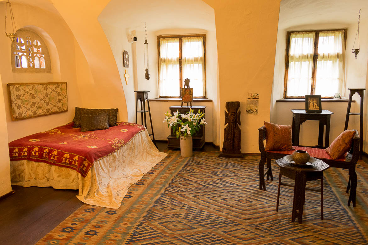 This is a photo of Queen Marie's bedroom in Castelul Bran. Enjoy a half day trip from Brasov to Bran Castle.