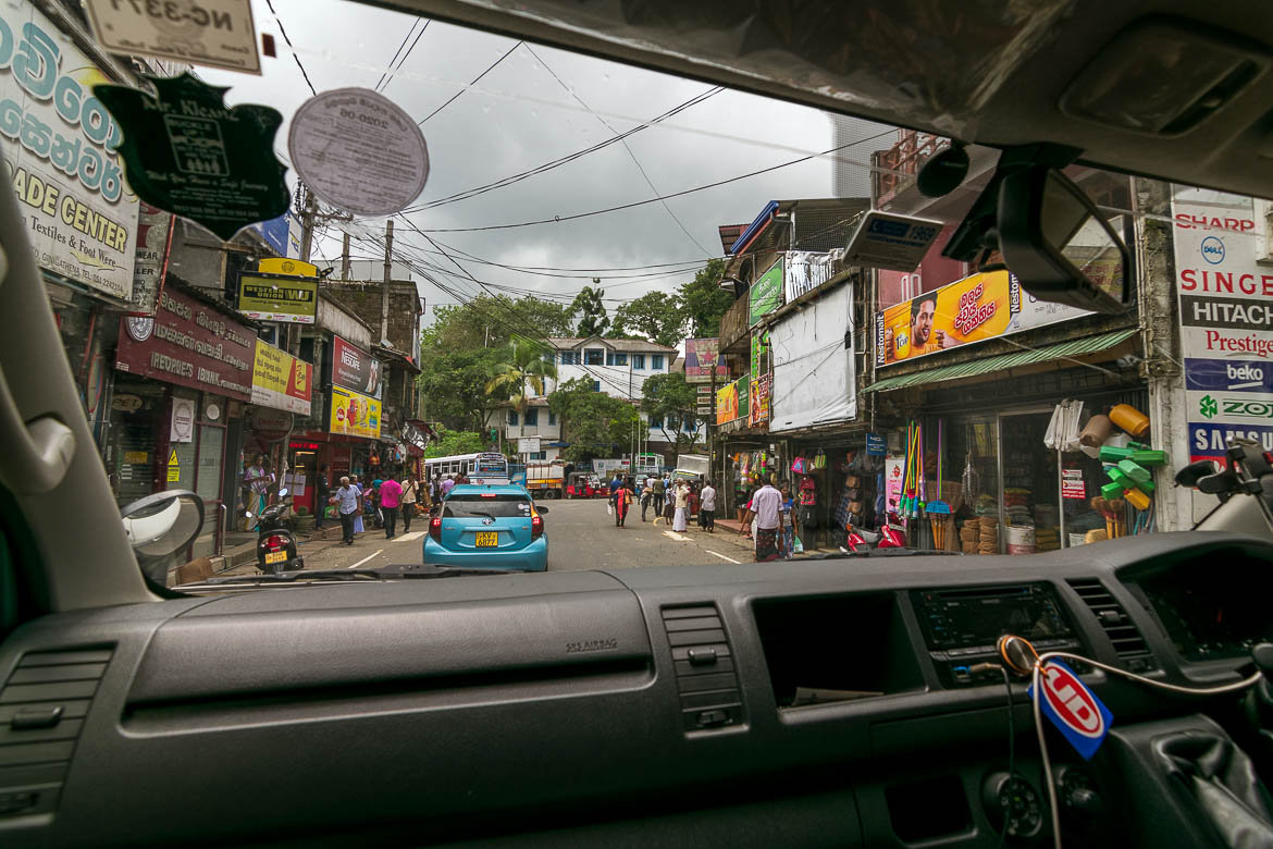 This photo shows a neighbourhood in rural Sri Lanka as seen from inside the car.
