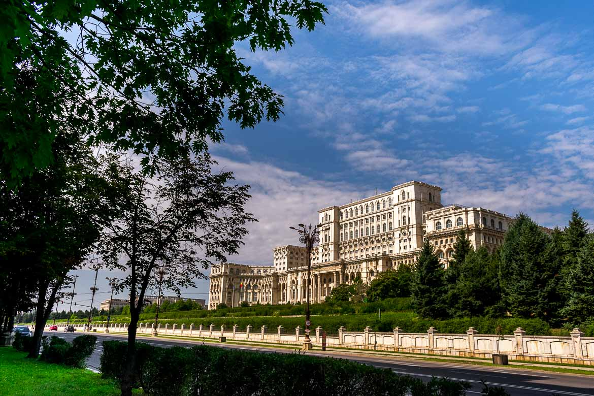 This image shows the Palace of Parliament in Bucharest, the most famous building in the city. The avenue in front of it is completely empty of cars.