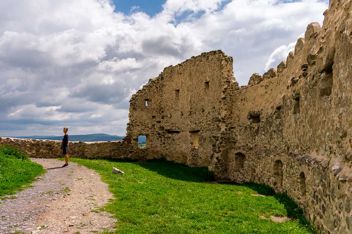 This image was shot inside Rupea Fortress. It shows the walls of the fortress in absolute peace and quiet. Only one person is standing on a quaint dirt road.