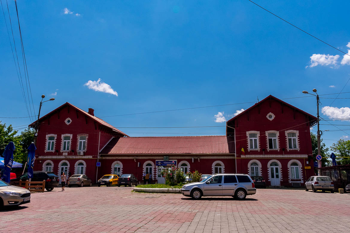 This image shows the red train station building in Targoviste.