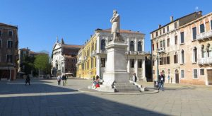 This photo shows Campo Santo Stefano in Venice, Italy with the statue of N. Tommaseo. What to do in Venice: our complete guide to La Serenissima.