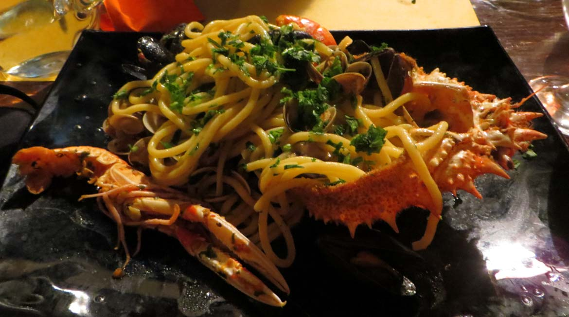 This photo shows a dish of seafood pasta in a restaurant in Venice, Italy. What to do in Venice: our complete guide to La Serenissima. Venice Italy. It's all trip to me.