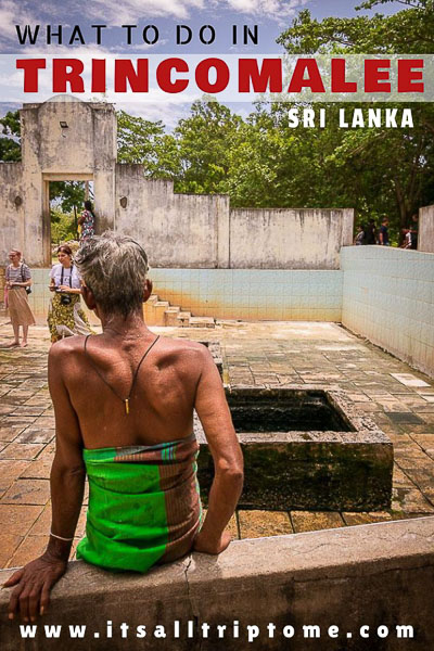 This photo shows a Sri Lankan man with his back turned to the camera sitting in front of a well at the Kanniya Hot Springs near Trincomalee in Sri Lanka. This is an optimised image for use on Pinterest. There is overlay text on it which reads: What to do in Trincomalee Sri Lanka. If you like our article, please pin this image.