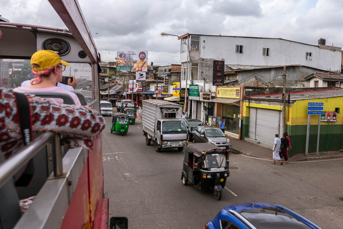 This photo was taken from the old fashioned open top double decker bus we hopped on for a tour of the City of Colombo as we were passing a busy downtown road.
