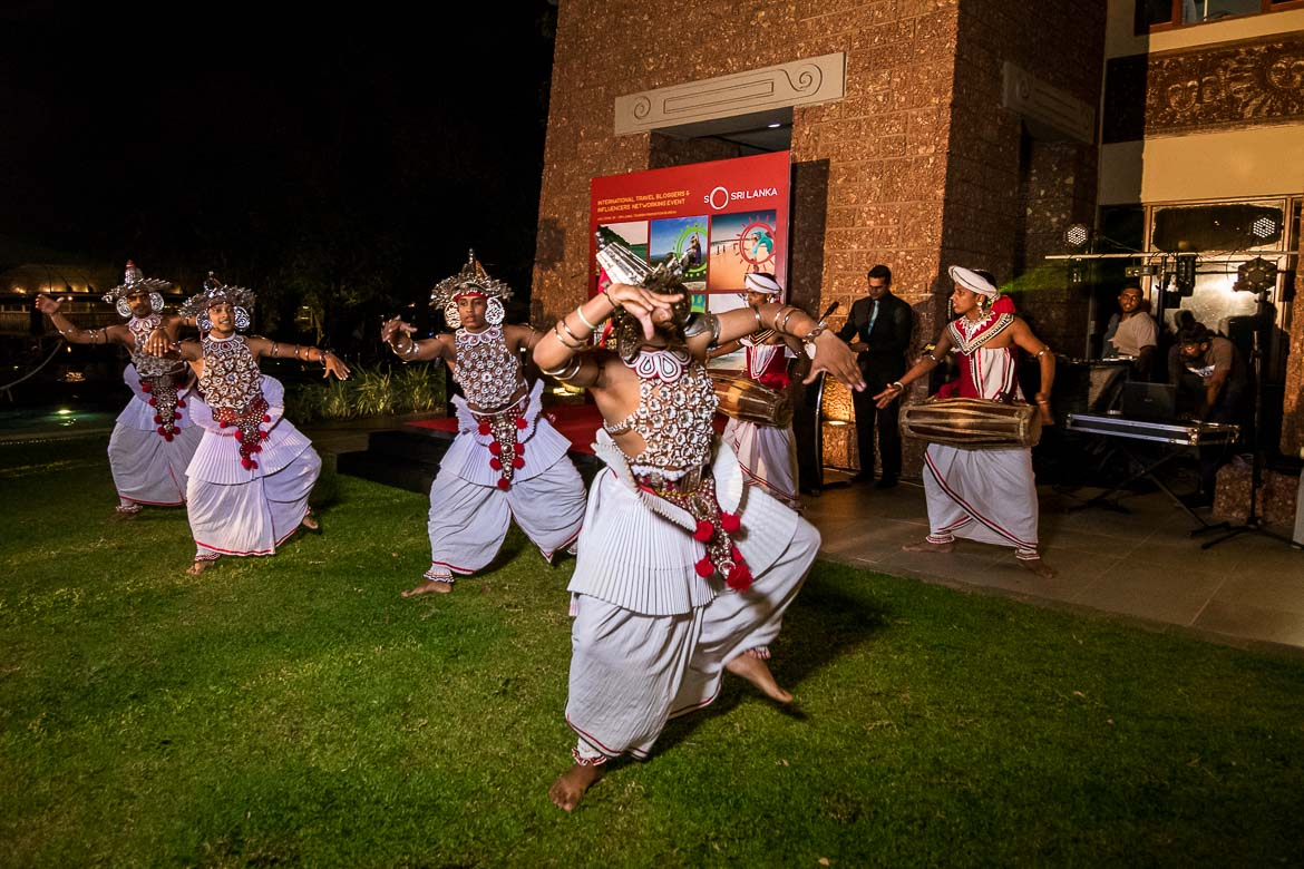 This photo shows Kandyan dancers performing their ritual dance wearing traditional costumes. This event took place at the garden area of Cinnamon Lakeside Hotel in Colombo, Sri Lanka and it was the best way to start off our Sri Lanka 10 day itinerary.