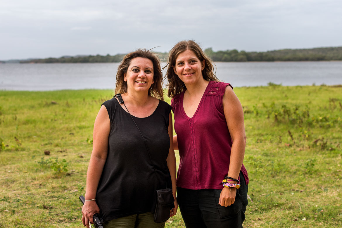 This is a photo of Maria and Katerina posing in front of Minneriya tank, happy to have seen so many elephants during their safari.