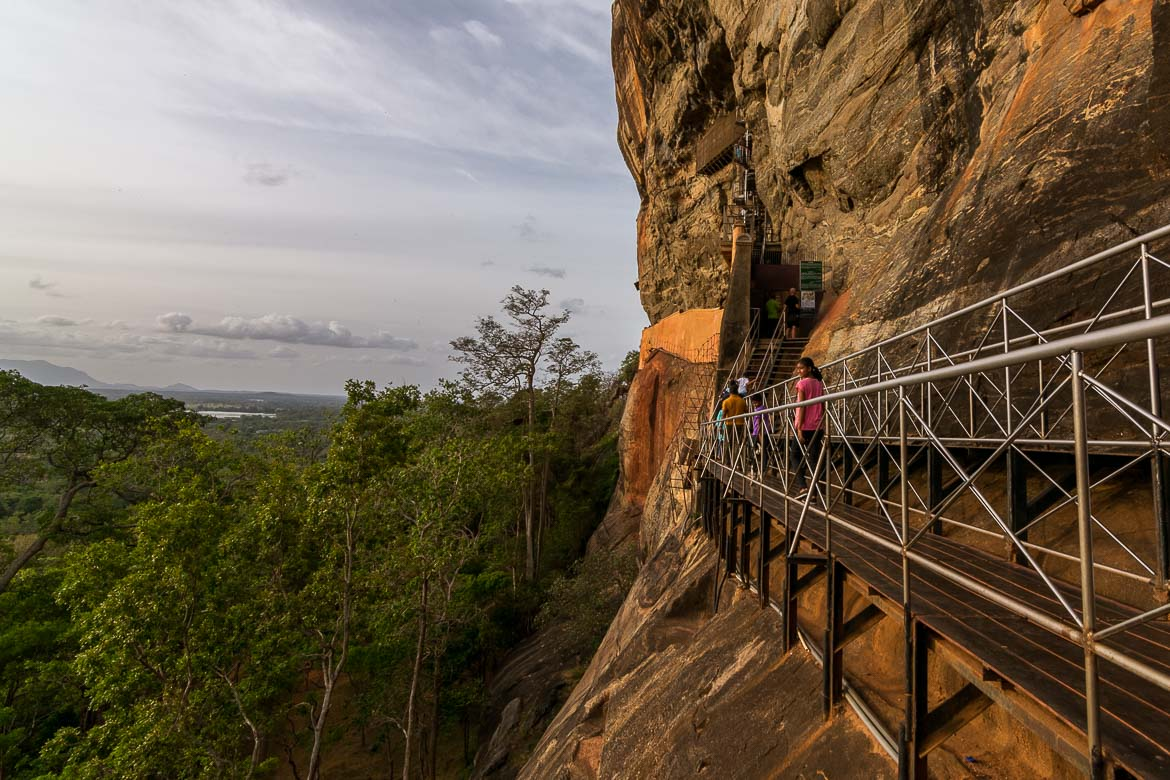 This image shows the path to the top of Sigiriya rock. It's narrow and high above the ground with spectacular views to the Sri Lankan countryside.