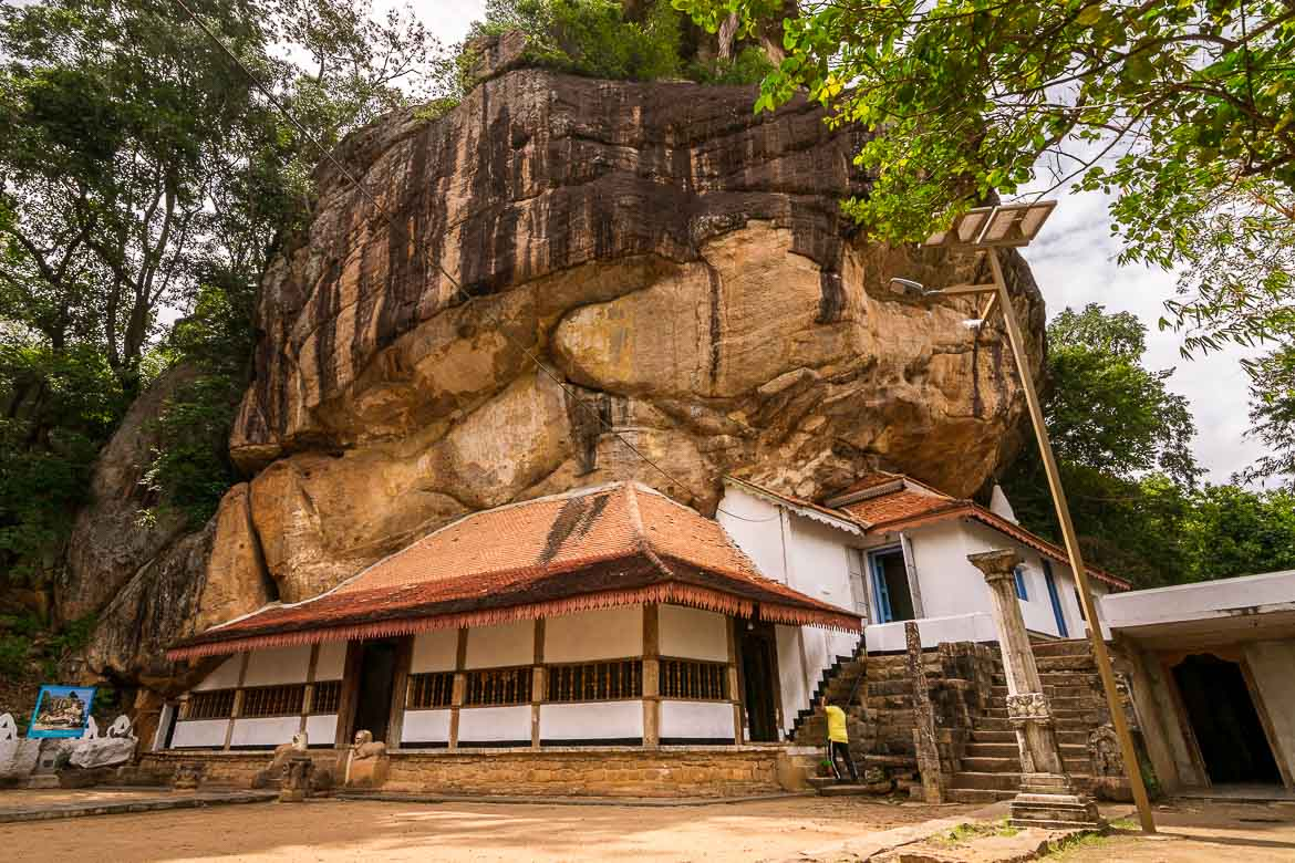 This is a photo of the Silver Temple which is built at the foot of a huge rock.