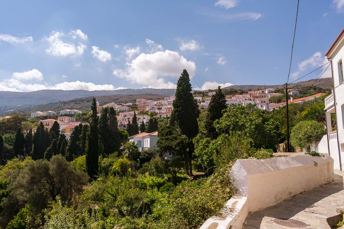 A panoramic view of Stenies Village in Andros Greece. 13 unique things to do in Andros Greece and full Andros Guide.