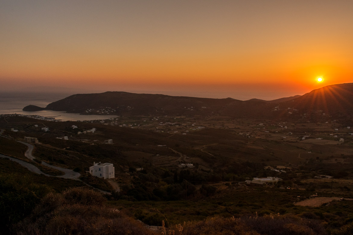 A sunset snapshot taken on the Vitali-Gavrio route. 13 unique things to do in Andros Greece and full Andros Guide.