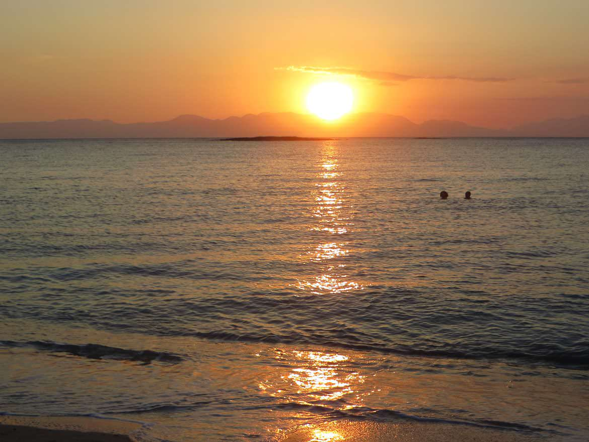 This photo shows Ta Nisia tis Panagias beach in Elafonisos, Laconia, Greece at sunset.